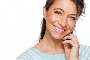 Middle aged woman pleased with her teeth whitening treatment