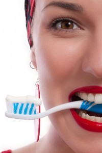 Woman with Red Lips Biting Toothbrush